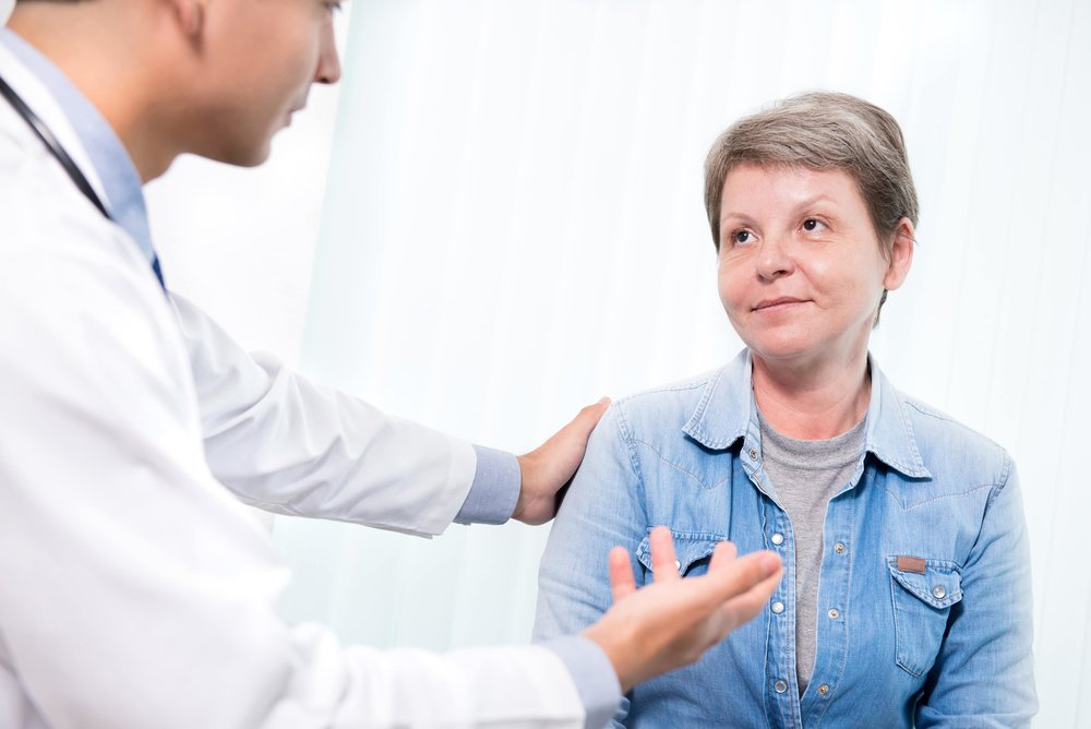 woman visiting doctor for treatment
