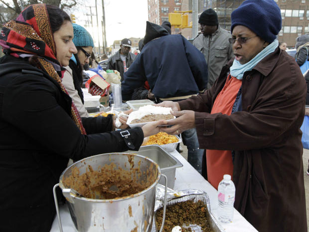 Neighbors handing out food to others