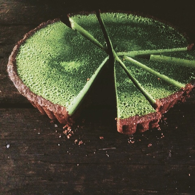 "Matcha Hemp Milk Custard tart with Hazelnut Cacao crust ... ""Say whaaaa..?!"" ° Inspired by the divine talent, Amy Chaplin. Her beautifully prepared food is conscious eating at its finest, you should pop over to @amychaplin and lose yourself. ° This here is a variation on theme created by Jase... ever curious➕wildly passionate. A tin of ceremonial-grade matcha, some research and a little experimentation resulted in this luscious, earthy-sweet treat. The juxtaposition between light matcha custard and nutty textural crust is as symphonic as it looks.  Food and eating is a ceremony to make your body n soul sing...live it and love it! 💚💚 Big loves 💚💚 🐰🚀 ° 🔽🔽recipe below🔽🔽"