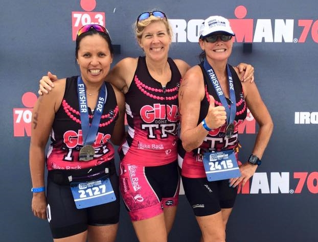 Christine Schirtzinger is a co-Lead Ambassador and founder of Girls Gone Tri.  (center)  Christine saw the need to bridge the gap for women who wanted to improve their health and have some fun through the sport of triathlon.  Her mission was to bring women together who could reach their unknown potential and through that concept, GGT was born.  Christine prides herself in being a most awesome spectathlete for every race she can get to, and is also an Ironman Triathlete who races at the elite level, competing in two Ironman 70.3 World Championships. She is a professional triathlon coach, helping athletes at all levels take their sport to that next level.  Christine also manages The Performance Center, a compu-trainer center at The Bike Rack.  Christine is a wife, and mother to four lovely young competitive athletes.