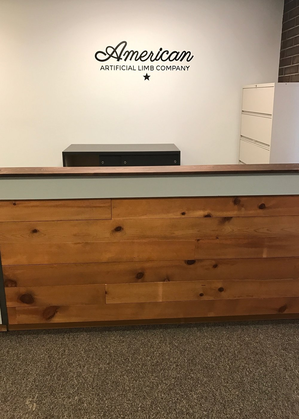 Our new reception desk- check out that snazzy logo!