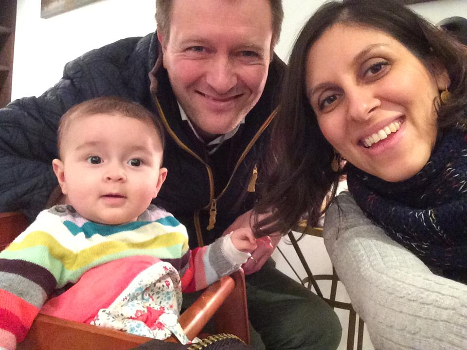 Family life: Richard Ratcliffe (centre) with his wife Nazanin (right) and their daughter Gabriella