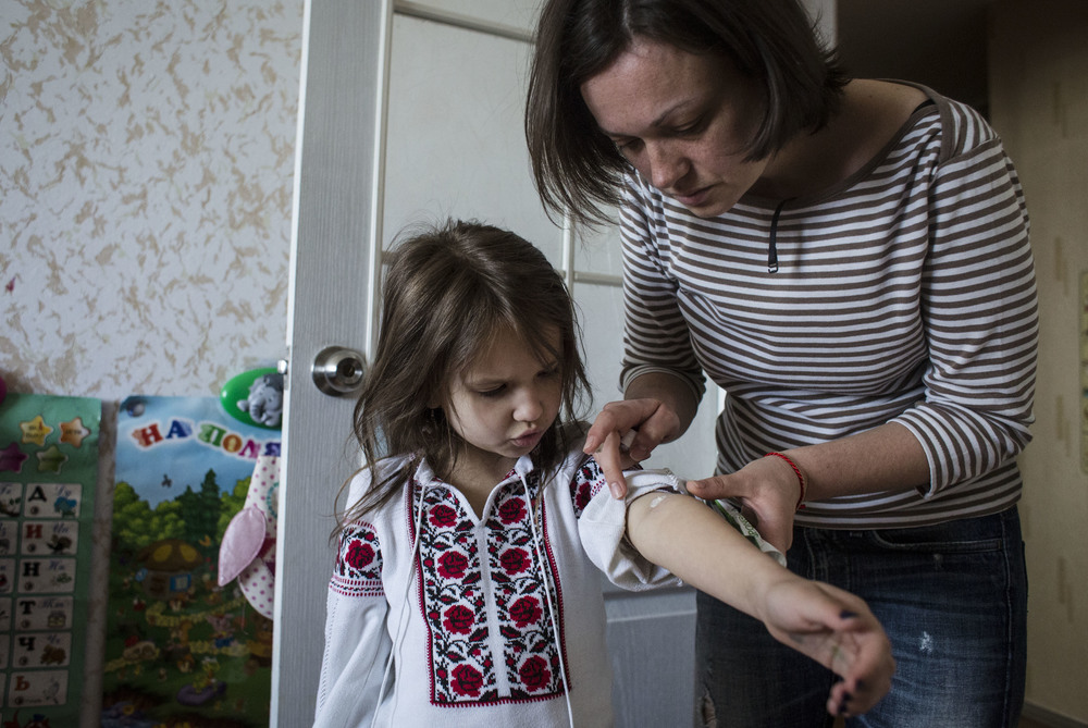 Nina Astaforova-Yatsenko (right) is being forced to buy medication for her daughter on the black market
