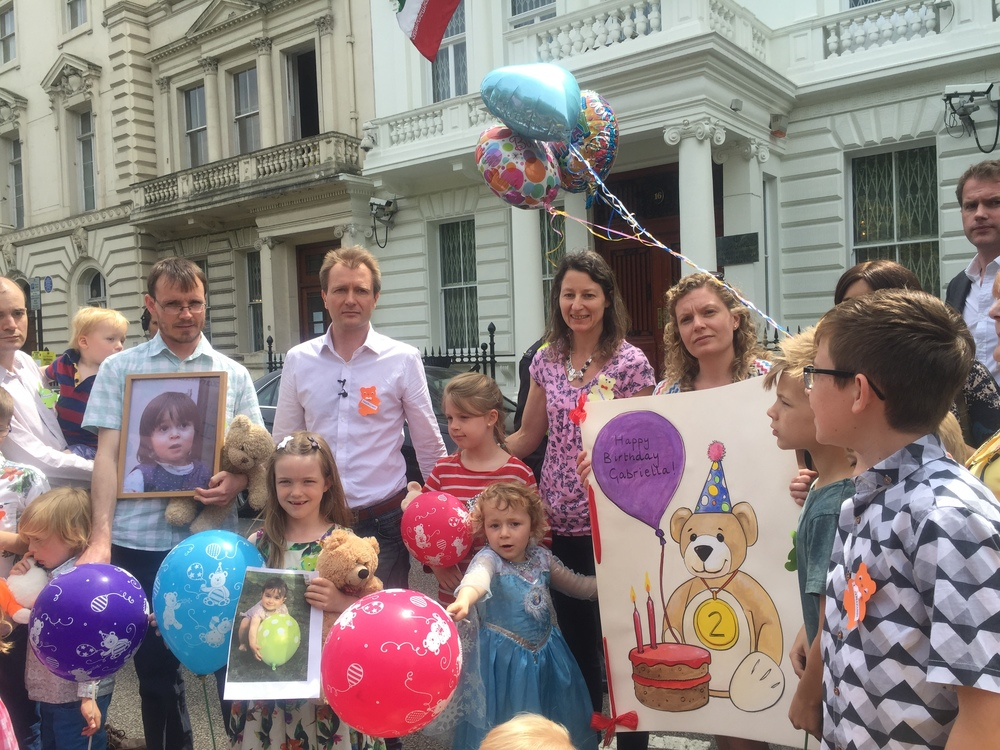 Happy Birthday: Richard was surrounded by friends, family and supporters of his petition outside the Iranian Embassy in London