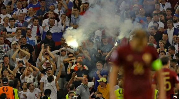 Clashes: Some Russia supporters had smuggled in flares which they set off at the end of the match
