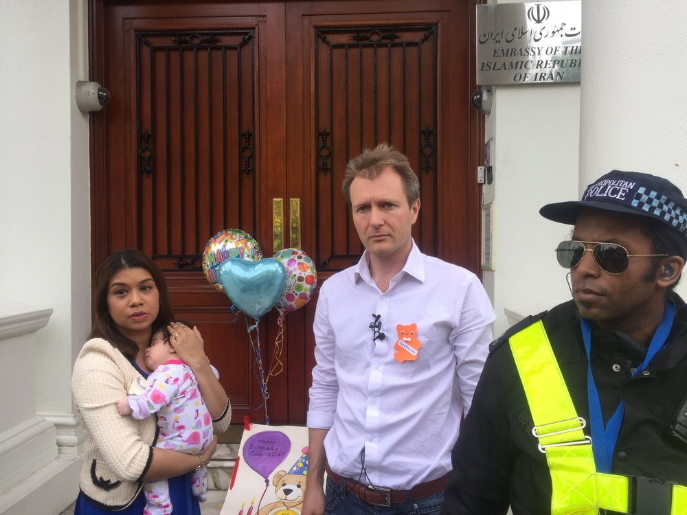 No entry: Richard (right) and his MP Tulip Siddiq (left) outside the Iranian Embassy where they left a card for Gabriella on the doorstep