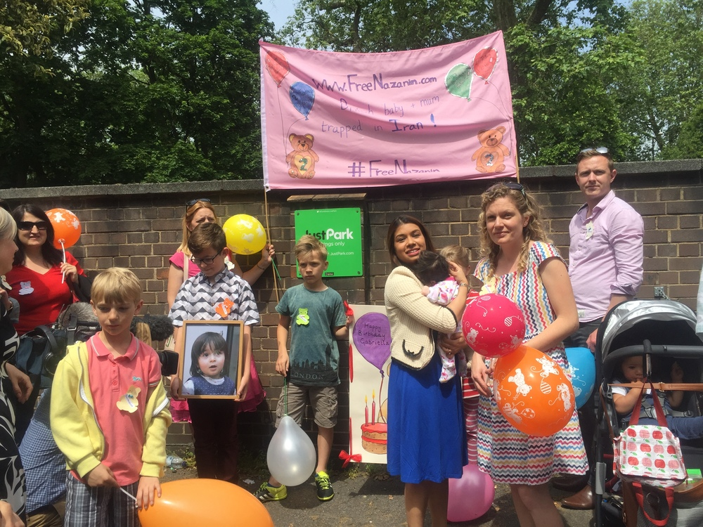 Many happy returns: Richard held a party outside the Iranian Embassy in London last week to mark daughter Gabriella's birthday while she is stuck in Iran