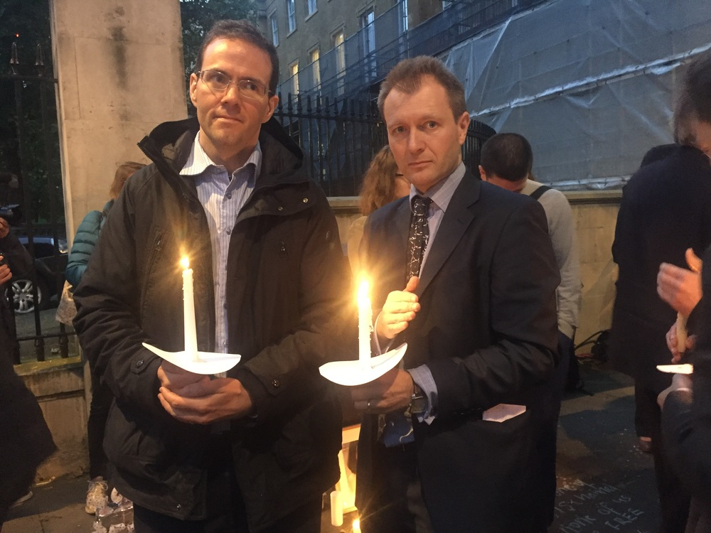 Vigil: The candle-lit event was organised by Kamran Foroughi (left) and Richard Ratcliffe (right) to mark the number of days their loved ones have been in prison