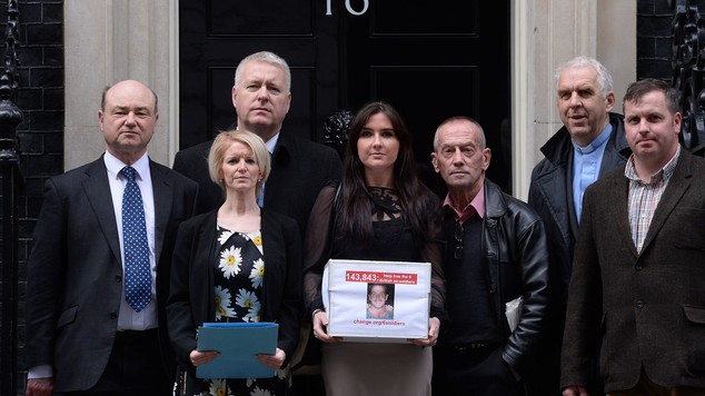 Release them: Yvonne McHugh, (centre), the partner of Billy Irving, and other family members of the six ex-servicemen at their previous petition to Downing Street