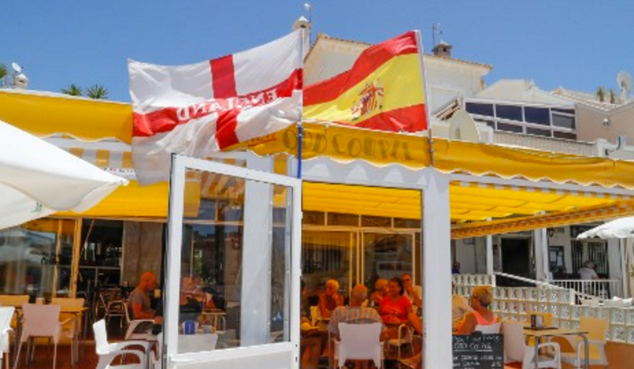 Fun in the sun: Brits enjoy a drink in Orihuela, the city with more British residents than anywhere else in Spain