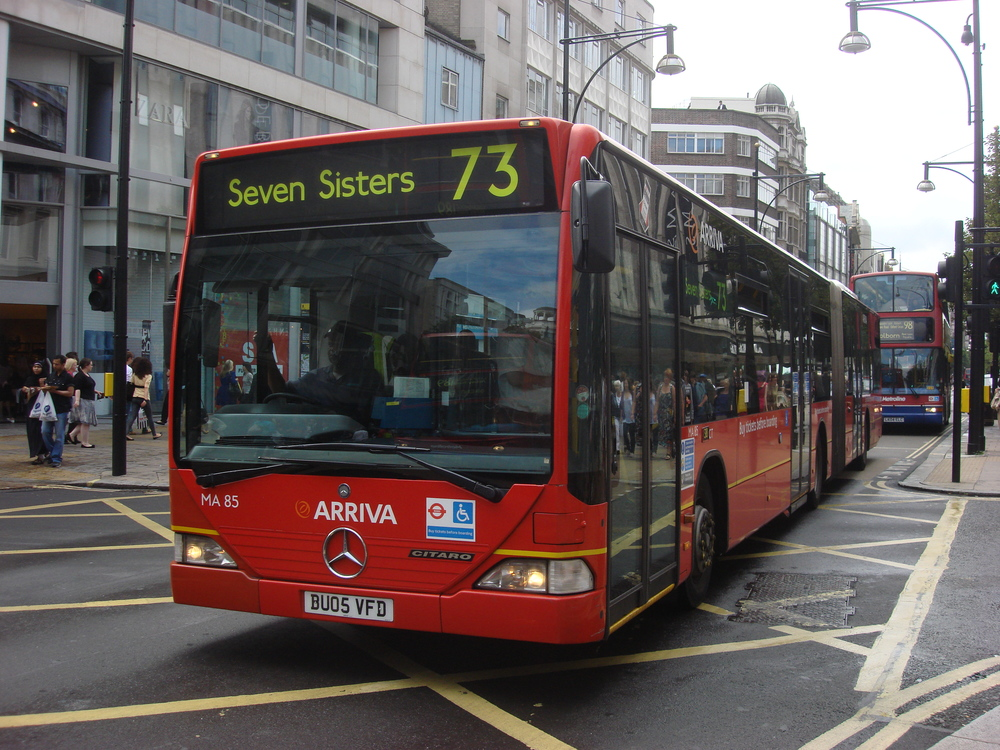 Collision: Tom was hit by a No. 73 bendy bus on Oxford Street as he returned to work