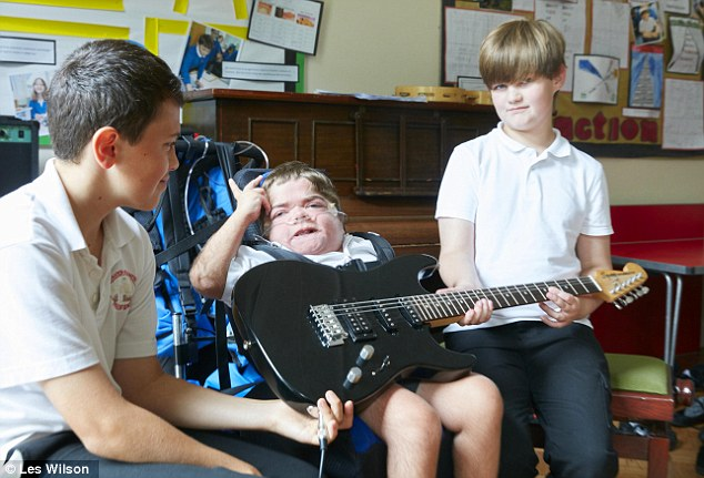Rock n roll: Jonathan plays guitar with his friends Sam Hughes (left) and Lewis Selina (right)