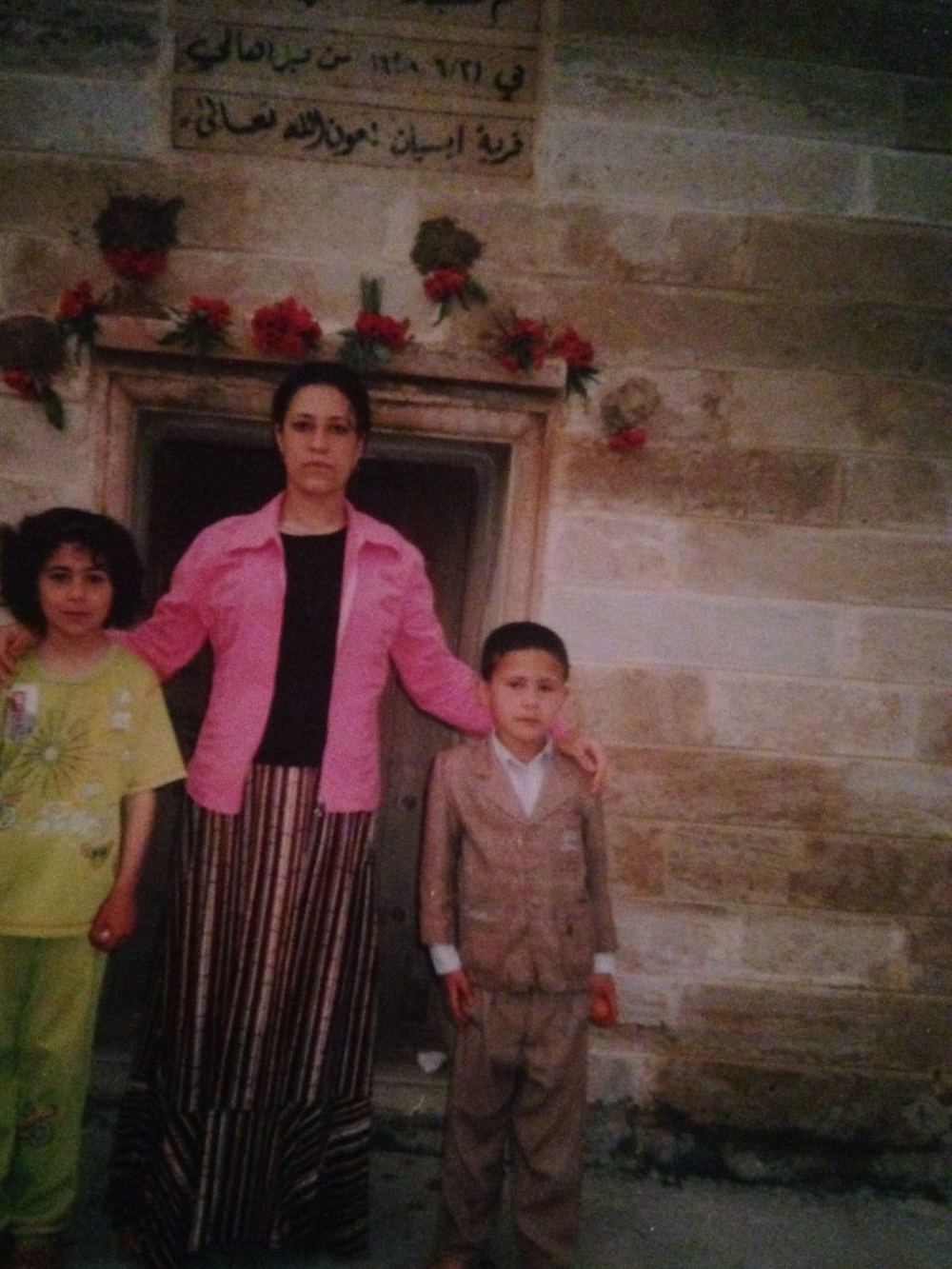 Homeland: Eight-year-old Rozin (left) with her older sister and one of her brothers in Essia, northern Iraq before the family left to join her father in the UK in 2008