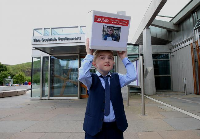 On top of the world: handing in over 130,000 signatures to Parliament
