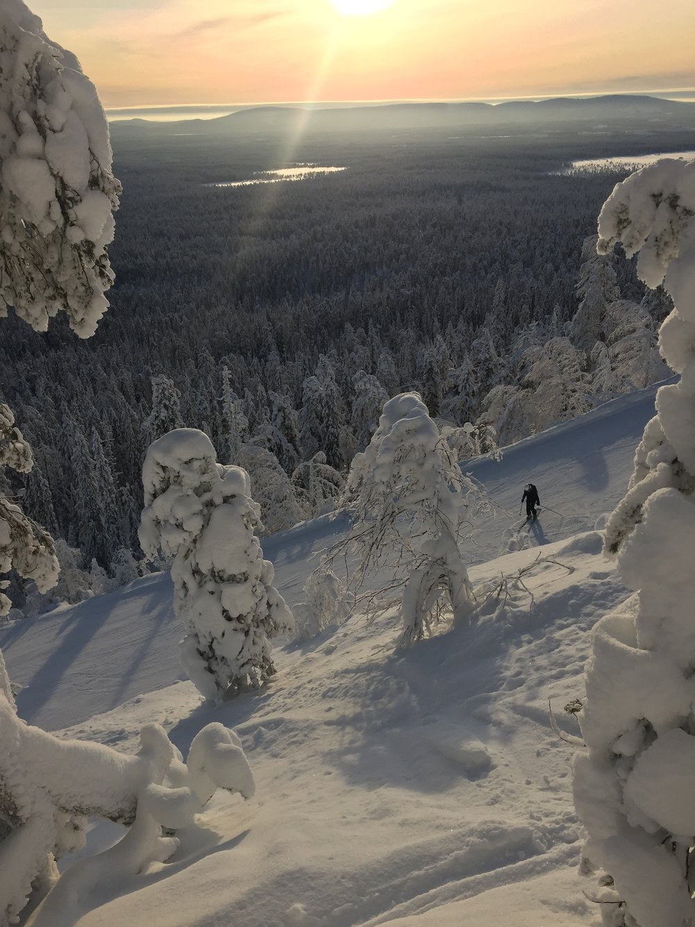 Jani took this photo of me slowly making my way down a black run one afternoon. The view is just amazing <3