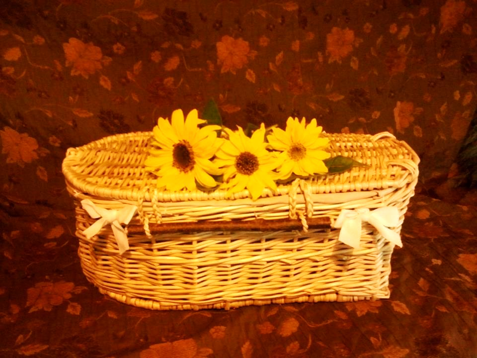 Cradle_To_Grave-Childs_Willow_Coffin_With_Flowers.jpg