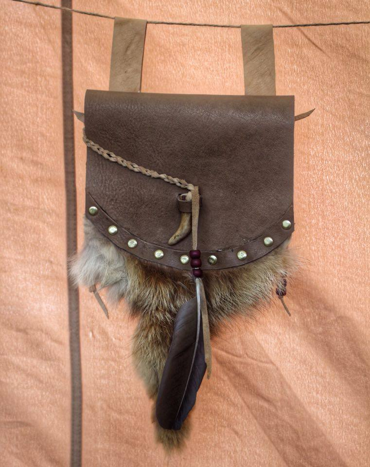 brown leather pursewith antler toggle,fur and feathers  £40