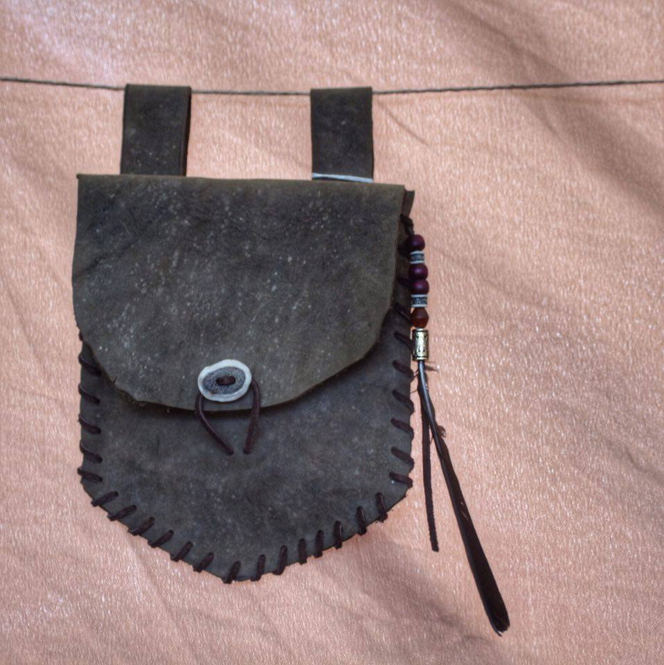 grey leather bag with beads ,feathers and stag button fastener  £30