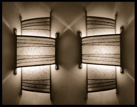 PAIR OF SCONCES - inked, torn and collaged paper with wood frame