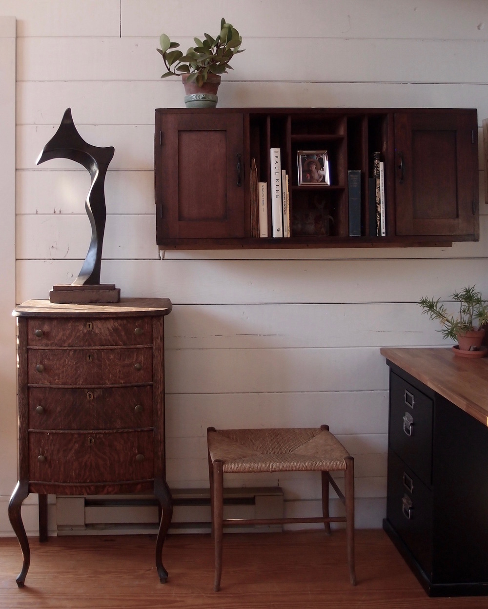 antique mail cabinet and sculpture by Justin Long