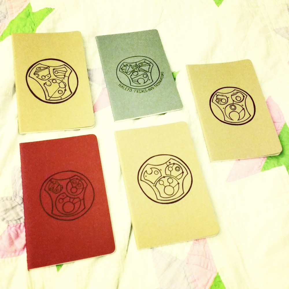 A batch of custom Gallifreyan notebooks I drew for  my Etsy shop  this past Christmas