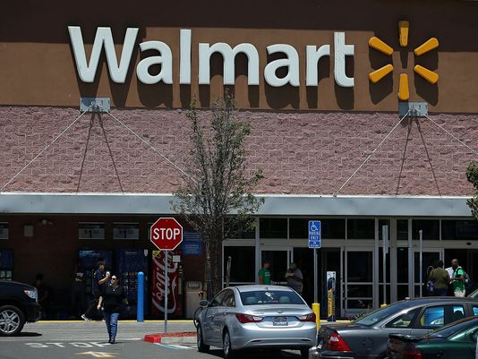 Walmart plans to close 269 stores globally and work on strengthening their Supercenters and Neighborhood Markets. Image via usatoday.com. (Photo: Justin Sullivan/Getty Images)