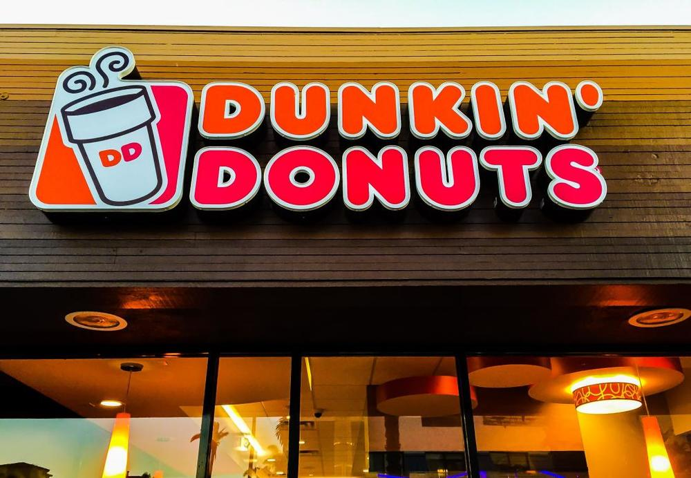 Dunkin' Donuts franchisees Amit and Kalpesh Patel plan to open their first restaurant in Detroit in 2017. Image via time.com. (Photo: Bob Berg/Getty Images)