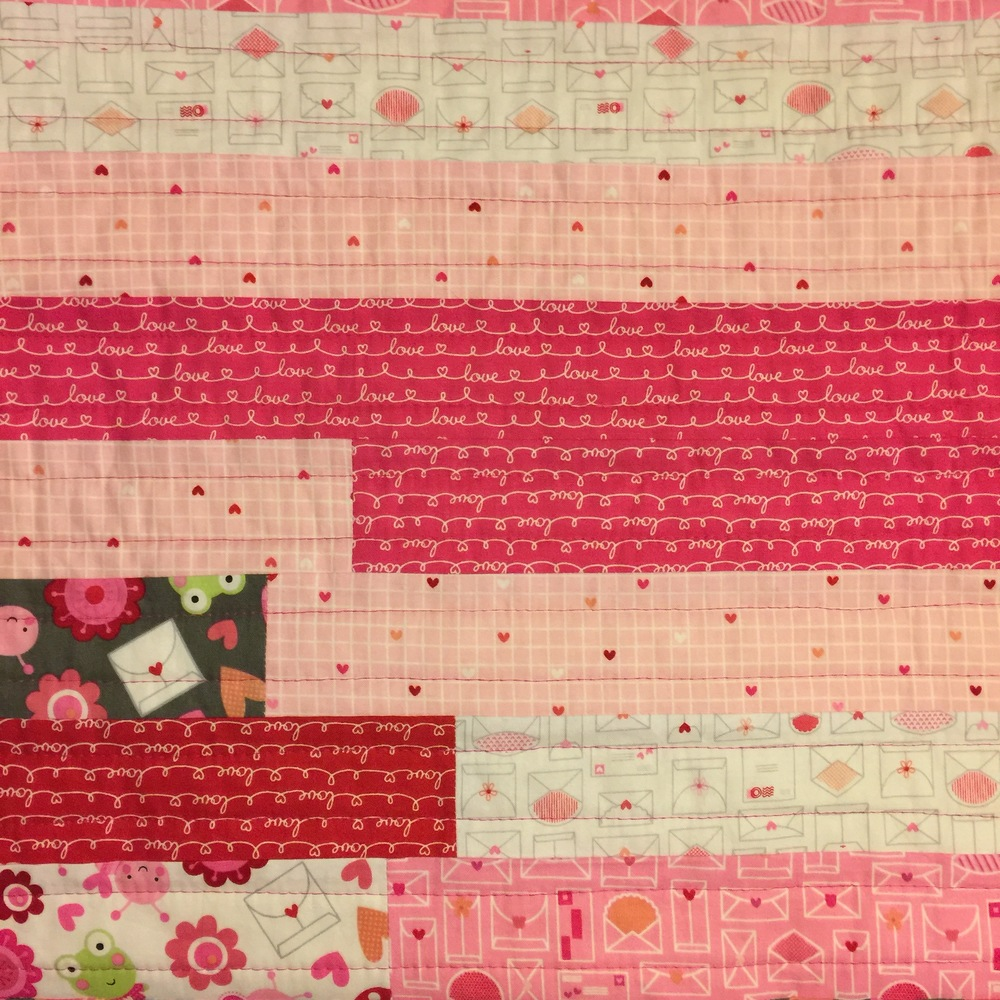 Jelly Roll Baby Quilt Tutorial: Straight line quilting on Jelly Roll quilt top complete