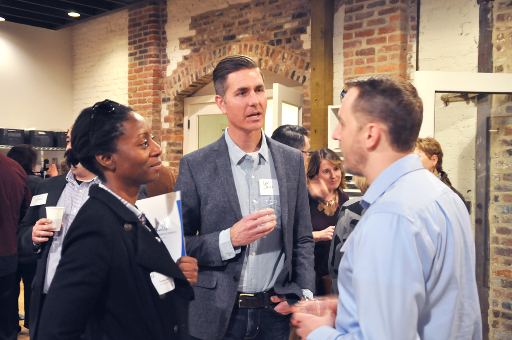 Tonya Lewis of The Post East and Lee Jones of Third Coast Design Studio discuss ScaleUp Nashville with Alex Mosley of Bridgestone at the Cohort's Kickoff Event.