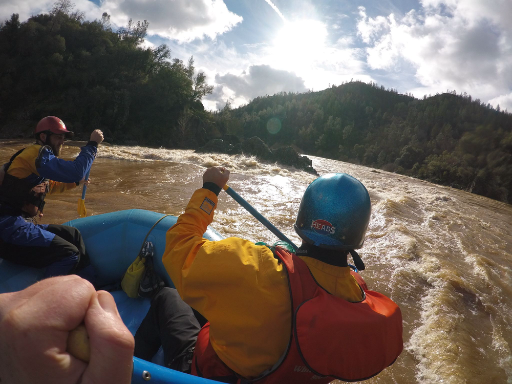 John K rafting The Gorge Section of the South Fork of the American River at 25,000 cfs. The rock you see is usually 15 feet out of the water.   photo courtesy of Tom MacDonnell of Sierra Mac