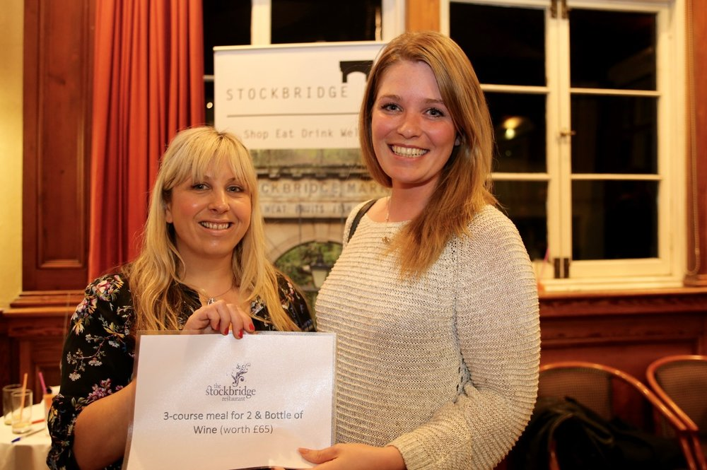 Nikki Christie (right) receives her prize – from Jane of Stockbridge Restaurant .jpg