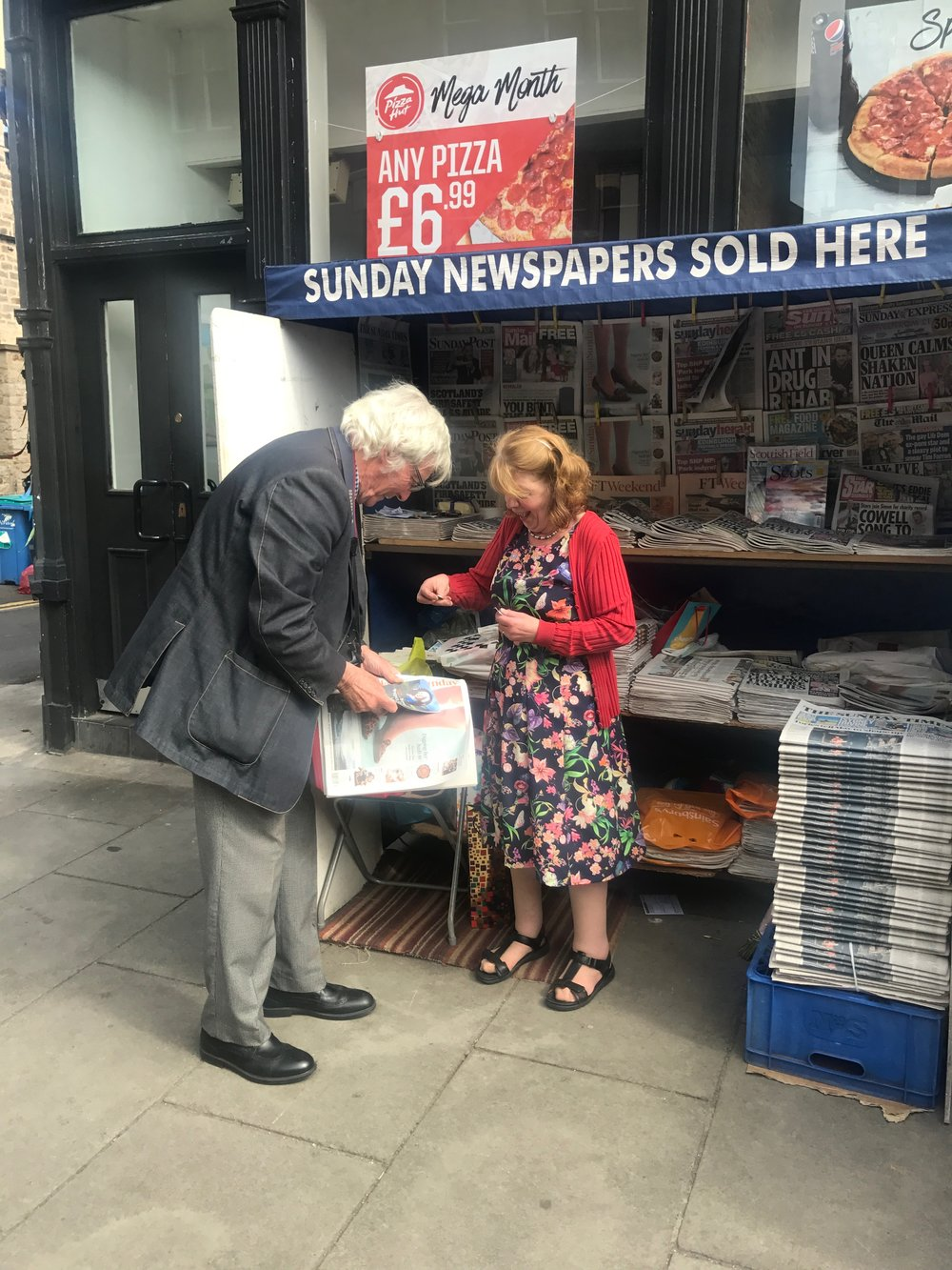Local buying his last paper from Moira