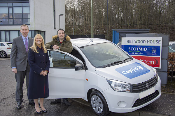 John Brodie MBE, CEO of Scotmid Co-operative, and Marlene Shiels OBE, the CEO of Capital Credit Union, present Richard Langan with his new Suzuki Celerio from the Belmont Group
