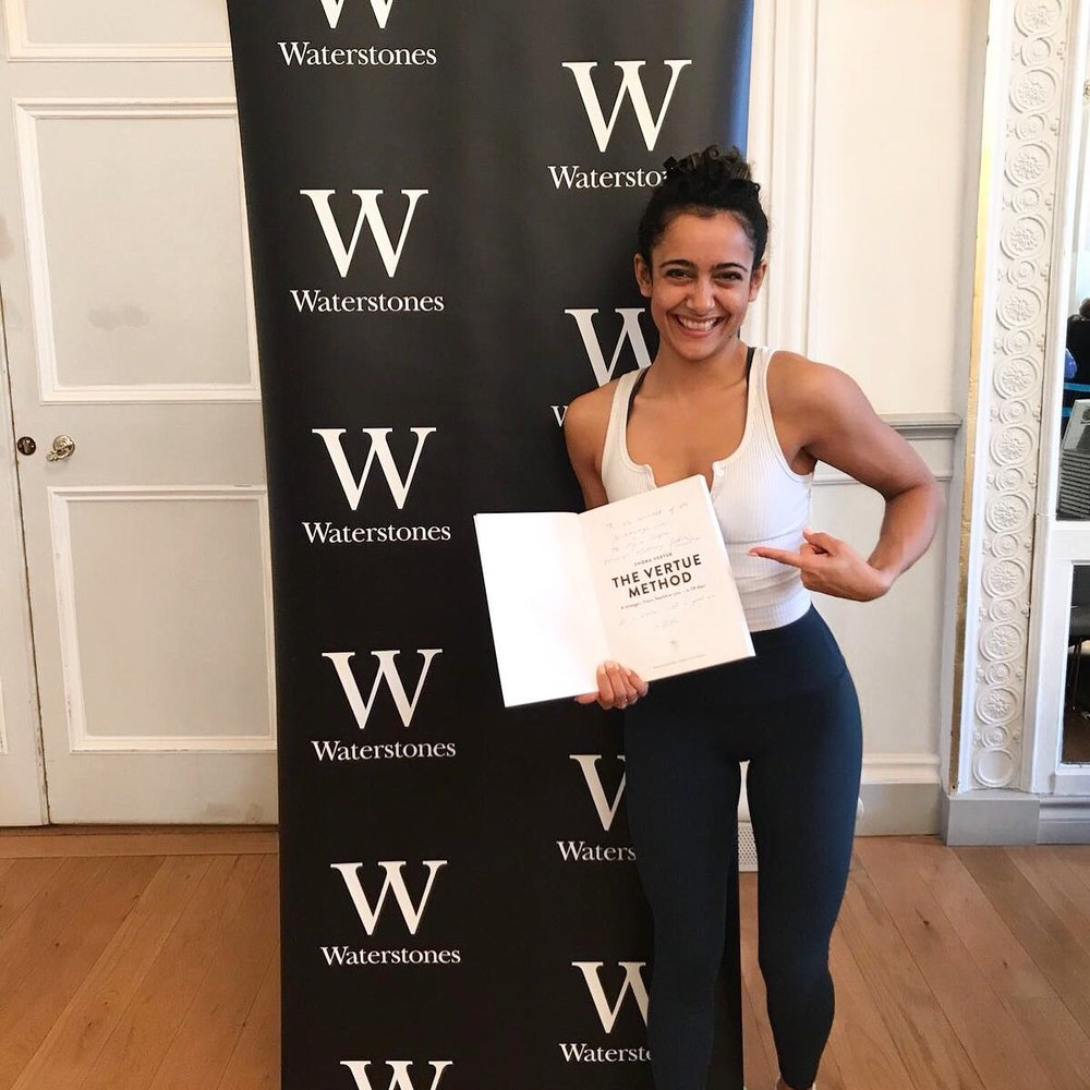 Devid Beckham's yoga instructor, Shona Vertue, with a signed copy of her book  The Vertue Method.
