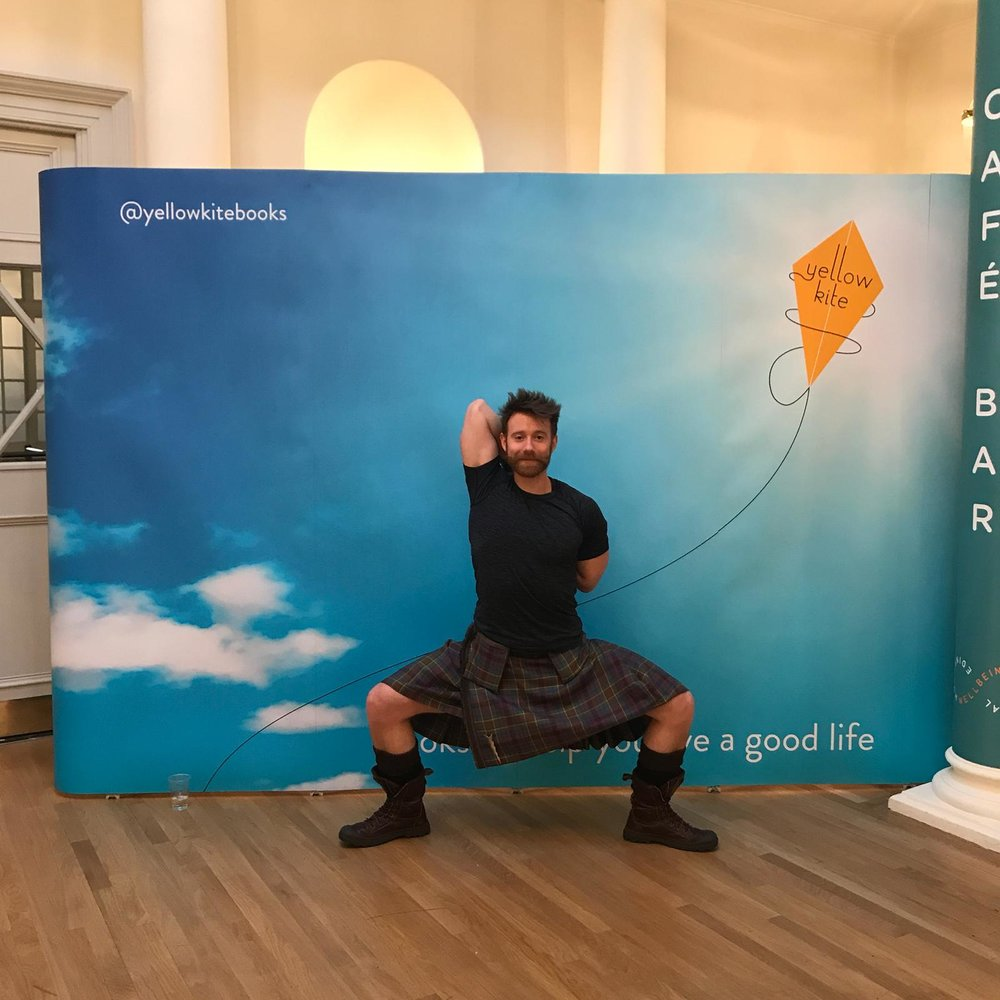 Kilted Yoga star, Finlay Wilson, posing for the camera at Edinburgh Wellbeing Festival on 27 Jan.
