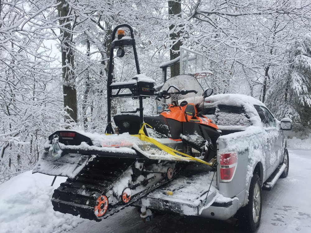 The snowmobile is on its way to be fixed.