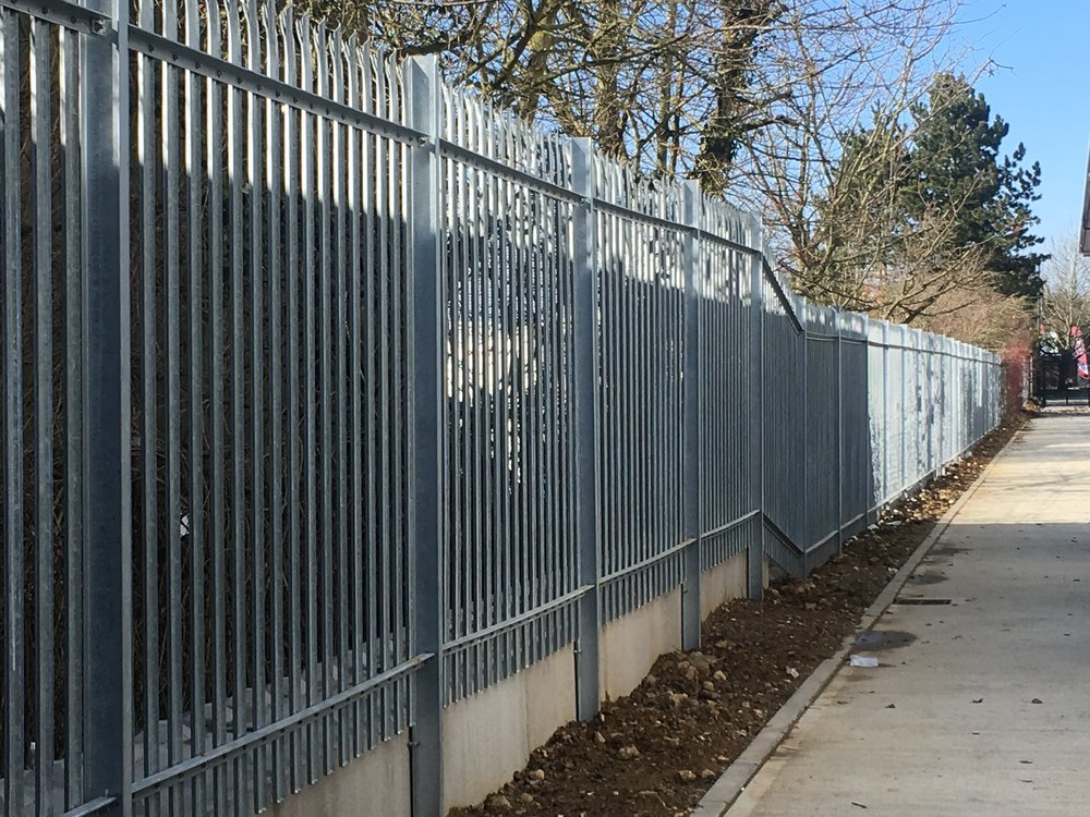 Clean lines, high fences, triple spike deterrents.
