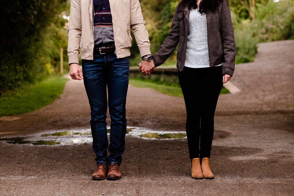 A couple holding hands standing side by side - Wirral Country Park, Merseyside, couples shoot