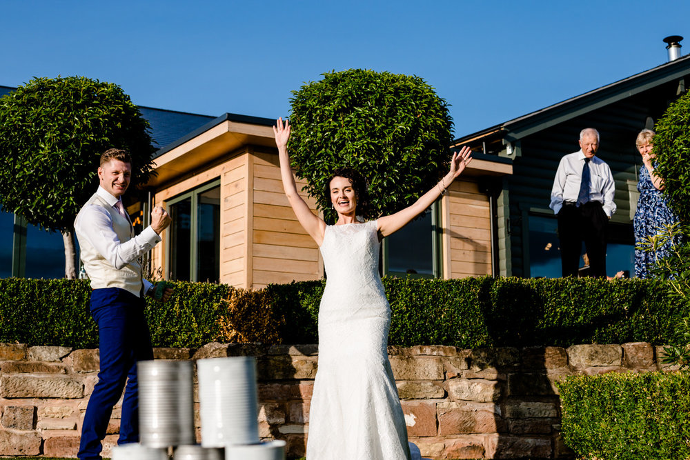 Bride and groom celebrating playing games at Pryors Hayes venue