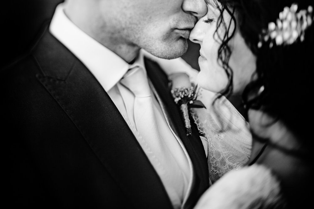 Close up black and white of a groom kissing his bride on the nose at Pryor Hayes Cheshire