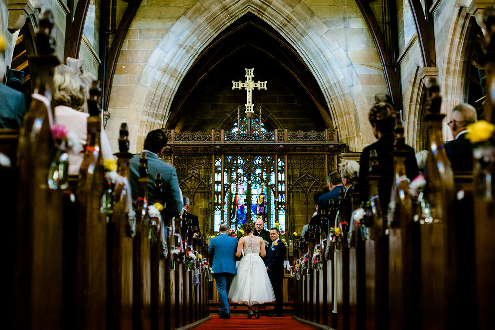 Christ Church Bebington in Wirral wedding, a view down the isle of a wedding.