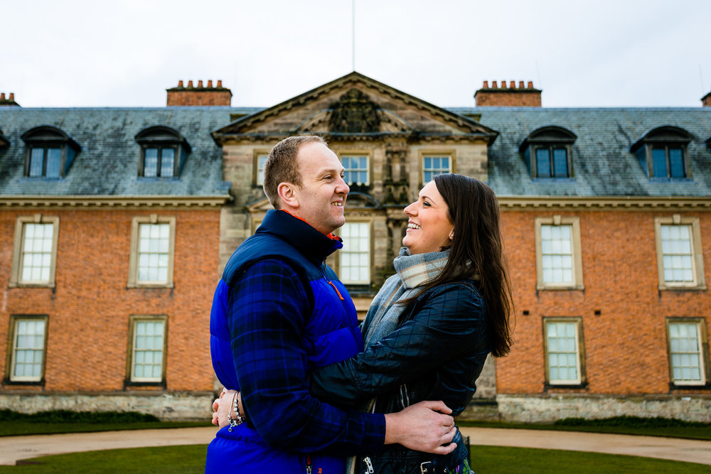 Claire and Damien laughing together in their Dunham Massey pre wedding shoot.