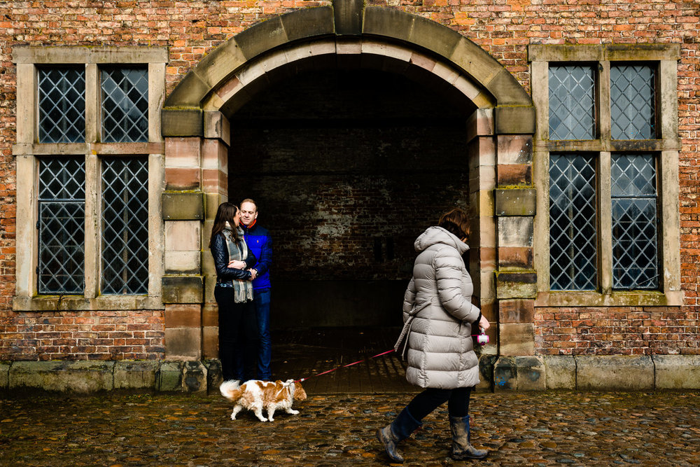 A dog walker passing by a couple at Dunham Massey.