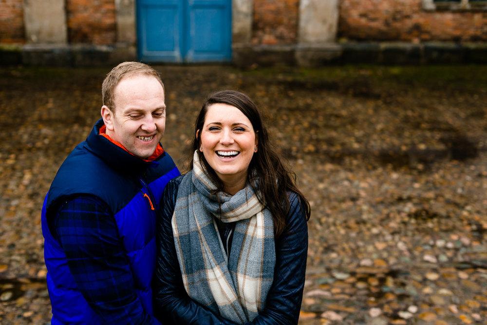 A pre wedding shoot photo at Dunham Massey, laughing couple.