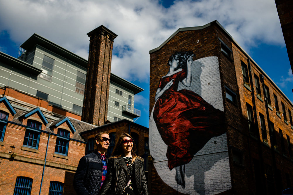 Cool couple on a sunny urban pre wedding shoot in the Northern Quarter, by Manchester wedding photographer.
