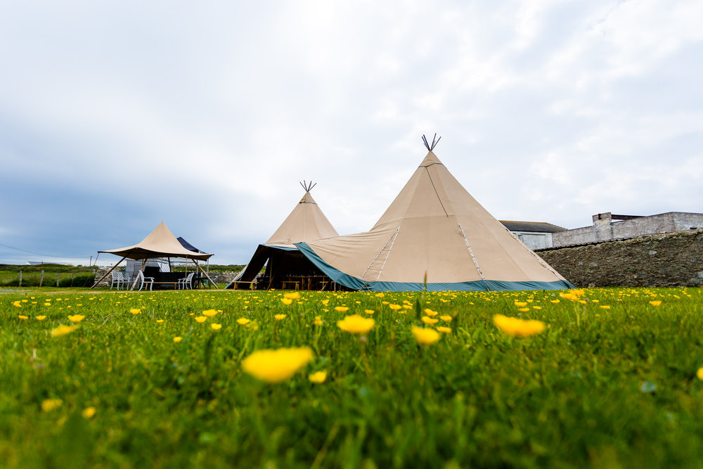 Wedding Tipi in a field for a relaxed festival wedding in Anglesey, Wales wedding photographer