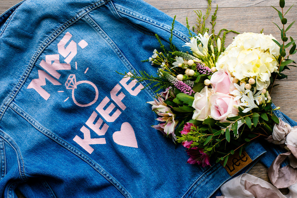 Festival Boho wedding styling, wild flower bouquet and cool printed denim jacket for a tipi wedding in Anglesey.
