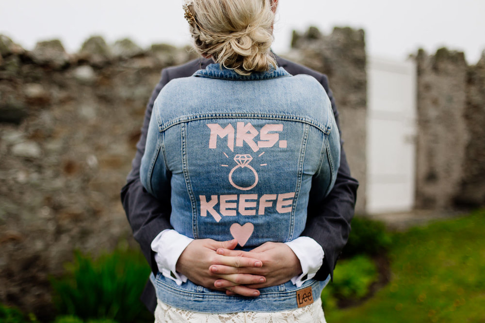 Bespoke wedding denim jacket with painted writing on the back.