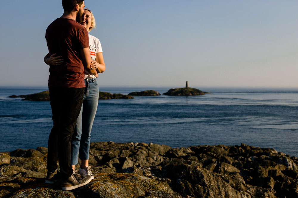 Anglesey pre wedding shoot, a couple stod on the headland looking out to sea.