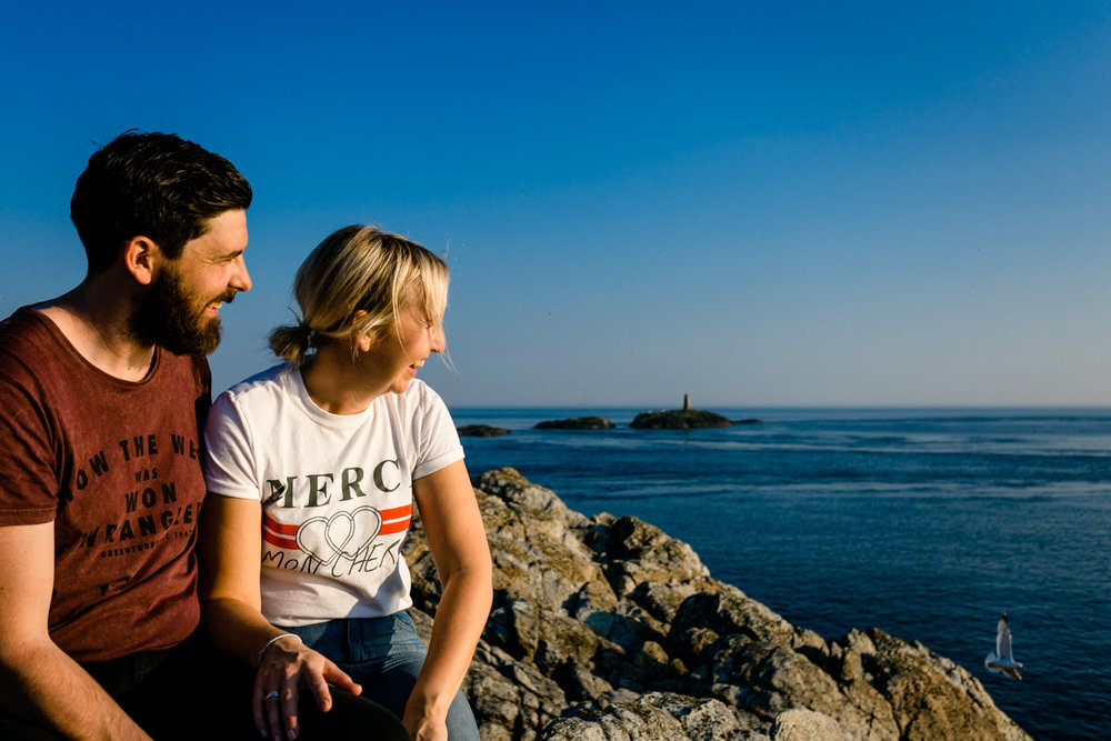 A couple on their pre wedding shoot on the Rhoscolyn headland. Anglesey wedding photographers.